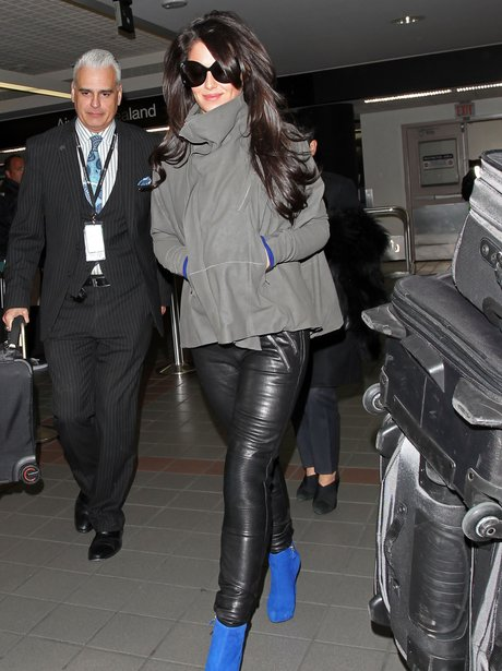 Cheryl Cole wearing  blue shoes at the airport