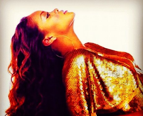 Rihanna wearing gold outfit
