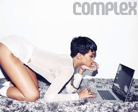 Rihanna using a computer in her underwear