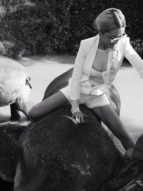 Rita Ora riding an elephant