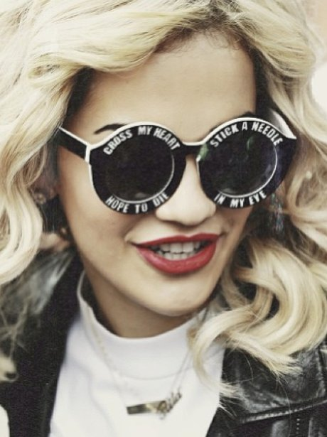 Rita Ora wearing sunglasses