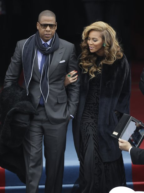 Jay-Z and Beyonce walking arm in arm