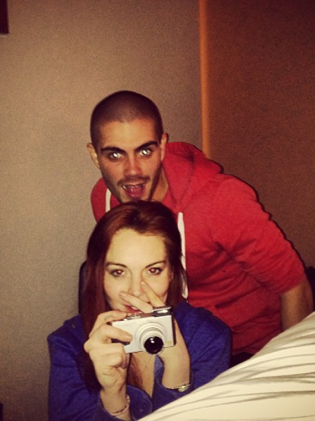 Linsay Lohan and Max George in a hotel