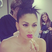 Image 7: Nicole Scherzinger applies some lipstick in the mirror