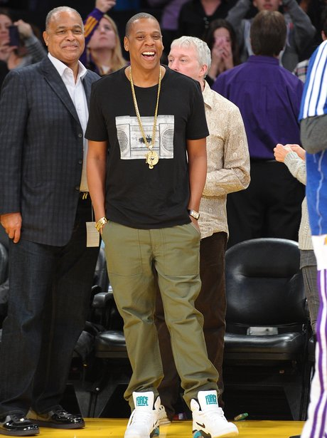 Jay-Z watches a basketball game in Los Angeles