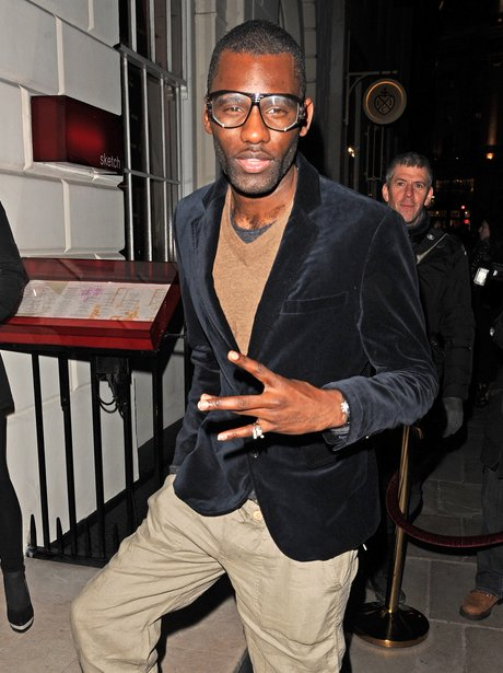 Wretch 32 poses for a snap in London