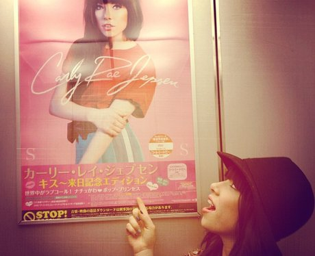 Carly Rae Jepsen next to her own poster in Japan