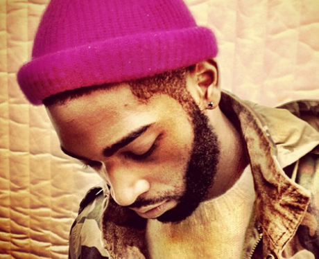 Tinie Tempah poses in a pink hat on Instagram