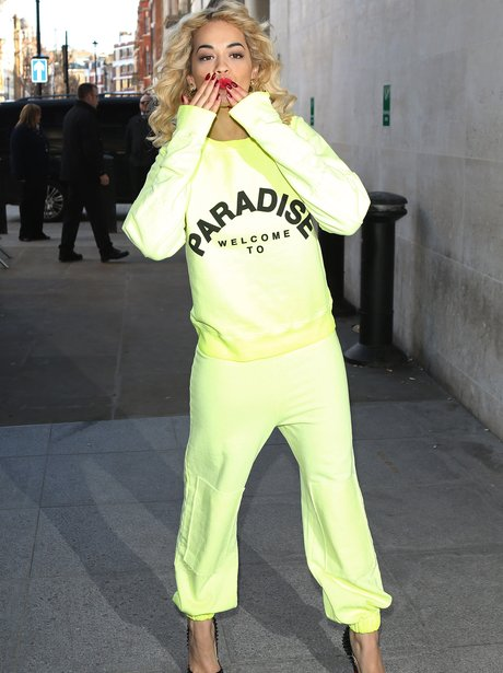Rita Ora wearing heals and a tracksuit