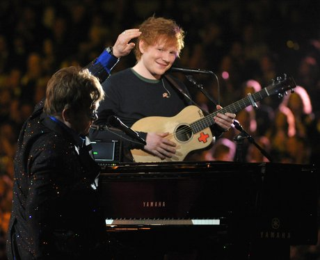 Sir Elton John and Ed Sheeran perform on stage at