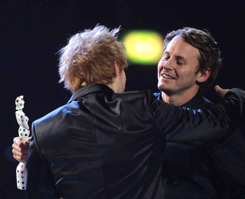 Ben Howard hugs Ed Sheeran