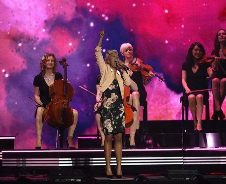 Emeli Sande kicks off her performance at the BRIT Awards 2013