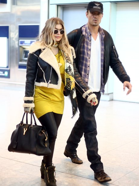 Fergie arrives at Heathrow Airport after announcing pregnancy