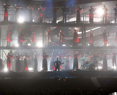 Muse on stage at the BRIT Awards 2013