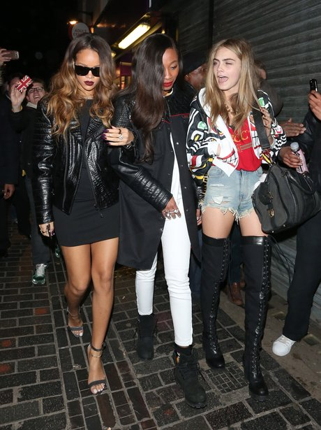 Rihanna and Cara Delevingne walking arm in arm in london