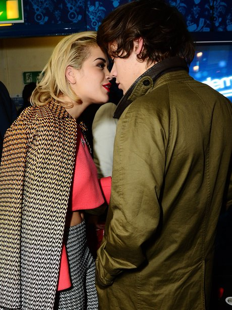 Rita Ora and Harry Styles almost kissing