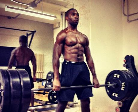 Tinie Tempah lifting weights in the gym