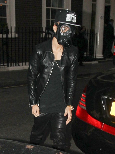 Justin Bieber wearing a gas mask in central London