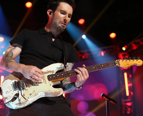 Adam Levine playing the guitar