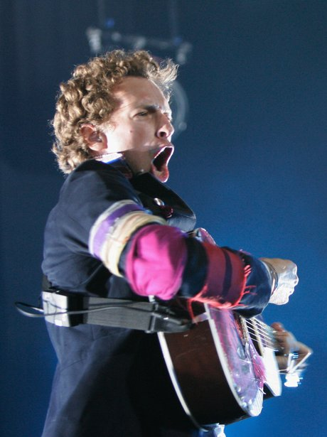 Chris Martin playing the guitar