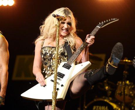 Ke£ha playing the guitar