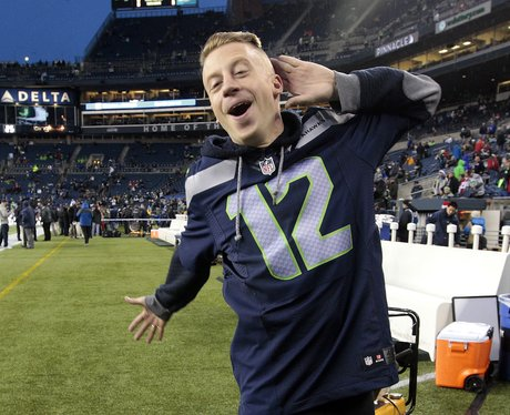 Macklemore wearing a football shirt at the NFL football game in Seattle
