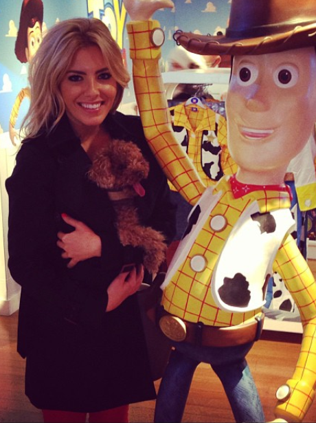 Mollie King and her puppy with Toy Story character