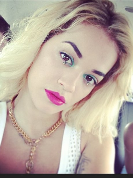 Rita Ora with tear-shaped make-up on Twitter