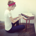 Image 3: Taylor Swift playing a small piano