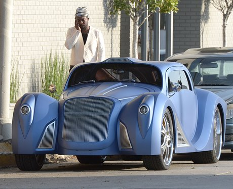 Will.i.am next to his custom made car