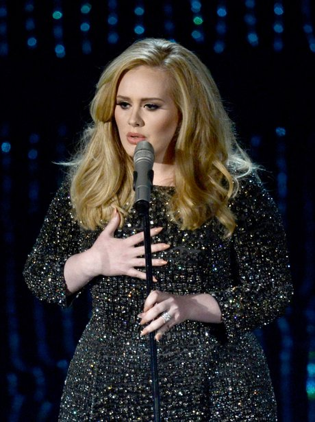 adele singing into microphone