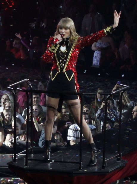 Taylor Swift wearing red costume on her world tour