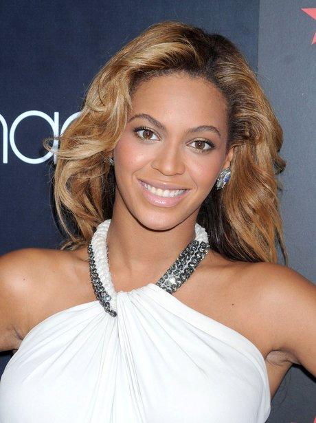 Beyonce wearing a white dress
