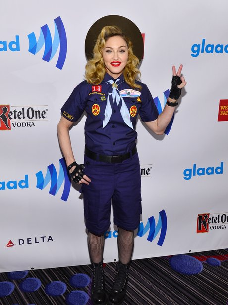 Madonna wearing a scout outfit
