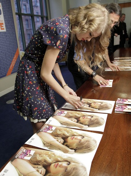 Taylor Swift signs autographs for fans