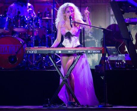 Rita Ora playing the keyboard