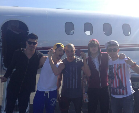 The Wanted outside their private jet