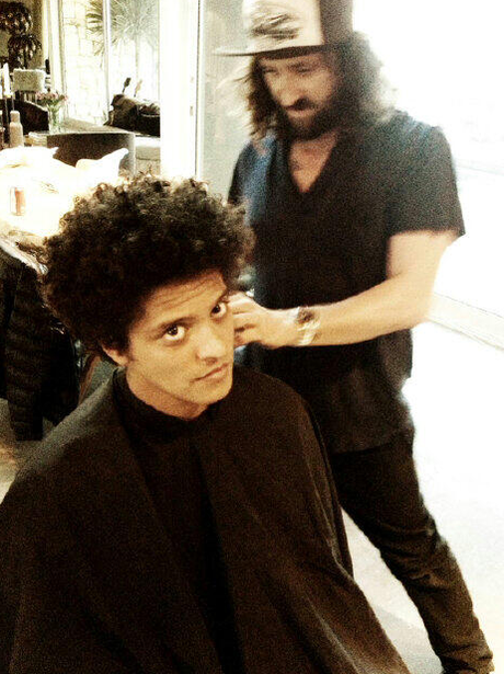 Bruno Mars gets his hair cut