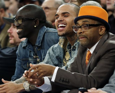 Chris Brown and Spike Lee take in a basketball game