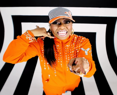 Missy Elliot making a phone me gesture