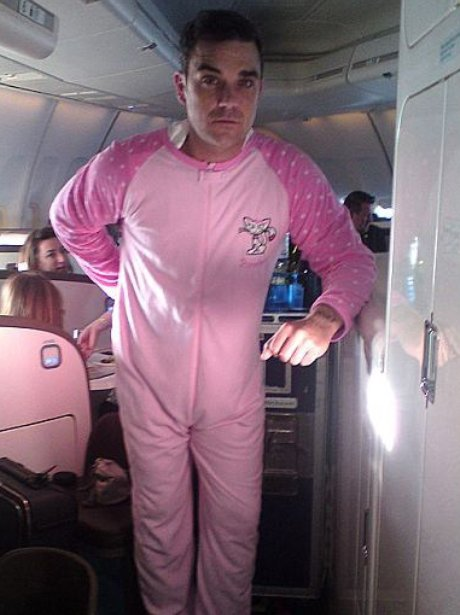 Robbie Williams in a onesie