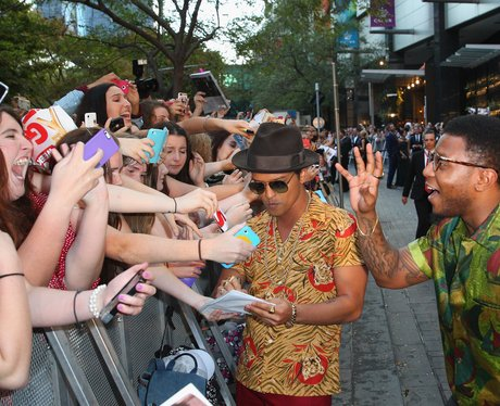 Bruno Mars is greeted by fans in Australia
