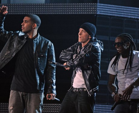 eminemm crossing his arms with Drake