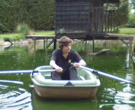 Harry Styles rowing a boat