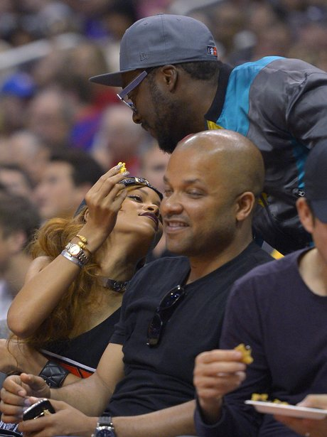 Rihanna and Will.i.am at the basketball match