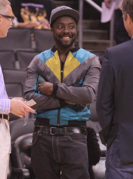 Will.i.am watching the basketball in Los Angeles