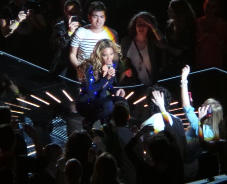 Beyonce surrounded by fans on Mrs Carter Show tour