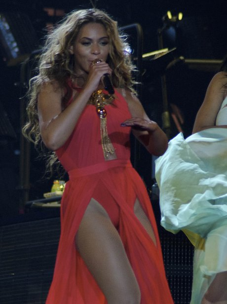 Beyonce wearing a red gown on Mrs Carter tour