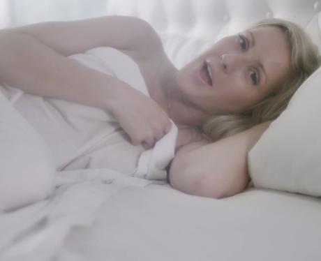 Ellie Goulding lying in bed