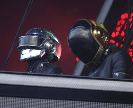 Daft Punk performing live on stage
